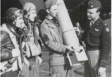 Examining an M46 Photoflash Bomb rated at 700 Million Candles are  1st Lt Robert P Walker (Pilot) 1st Lt William P Mishkho (Navogator) MSgt James M Tenille (Cief Armourer) Major Willis D Locke CO 654 Sdqn 25BG