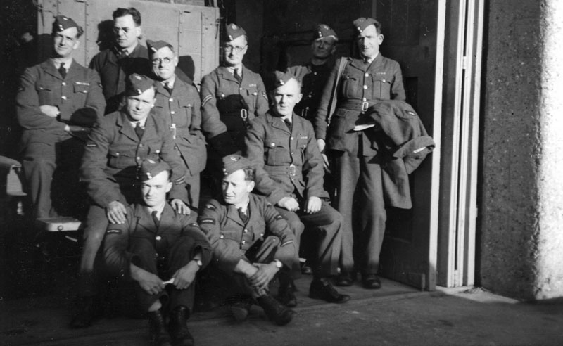 Unknown group of men out side their barracks. This is part of the group on parade and probably drivers.