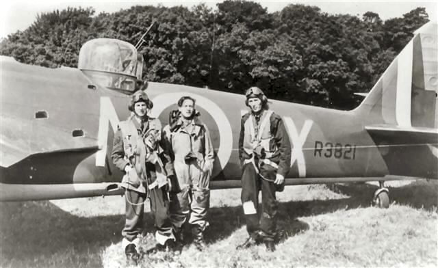 Pictured is R3821 with left to right, Sgt. Don A.W. McFarlane, Observer, Sgt. Peter K. Eames, Wireless operator/airgunner and Pilot Officer Donald M. Wellings, Pilot, in flying kit by R 3821. On 22 October1940, Eames and McFarlane were awarded the D.F.M., Wellings the D.F.C.