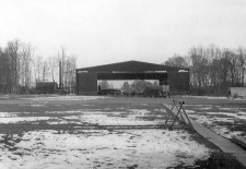 This is the old 527 Squadron hangar on the Griston side of the airfield at RAF Watton. Taken in 1954/55 it shows a Meteor NF 14 inside the hangar, you can tell the difference from the NF11 as that had a glasshouse type of canopy (Small panes of Perspex) whereas the NF14 had a one piece clear cockpit canopy. If you look closely you can see the tower of Griston Church through the hangar's open doors. This Hangar was a survivor from WWII, it was one of two built on the Griston side of the airfield for use by the USAAF 3rd Strategic Air Depot.
