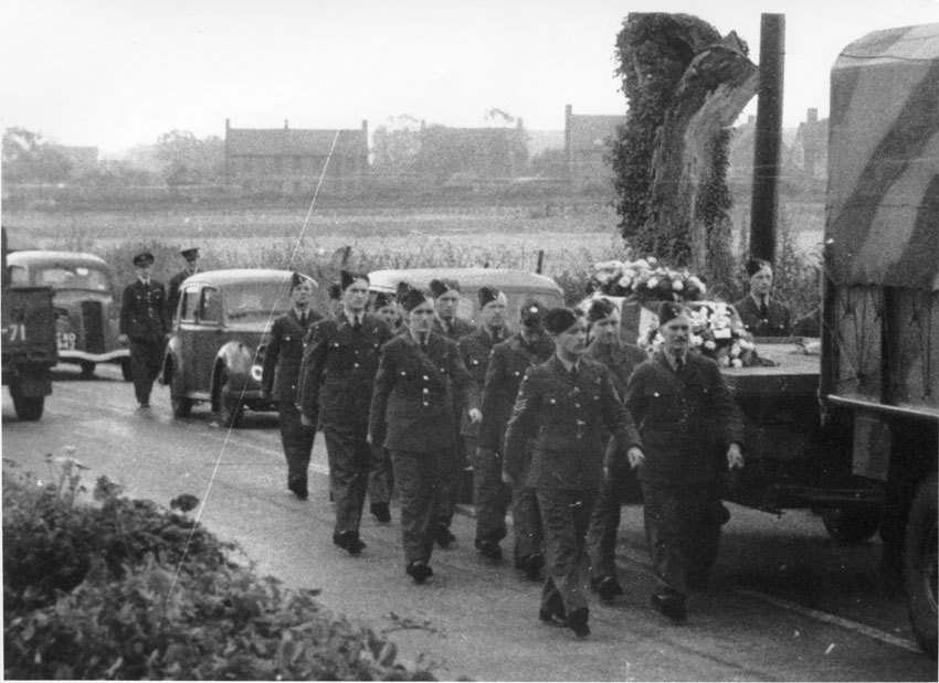 Marching down Norwich road. Officers quarters in background.