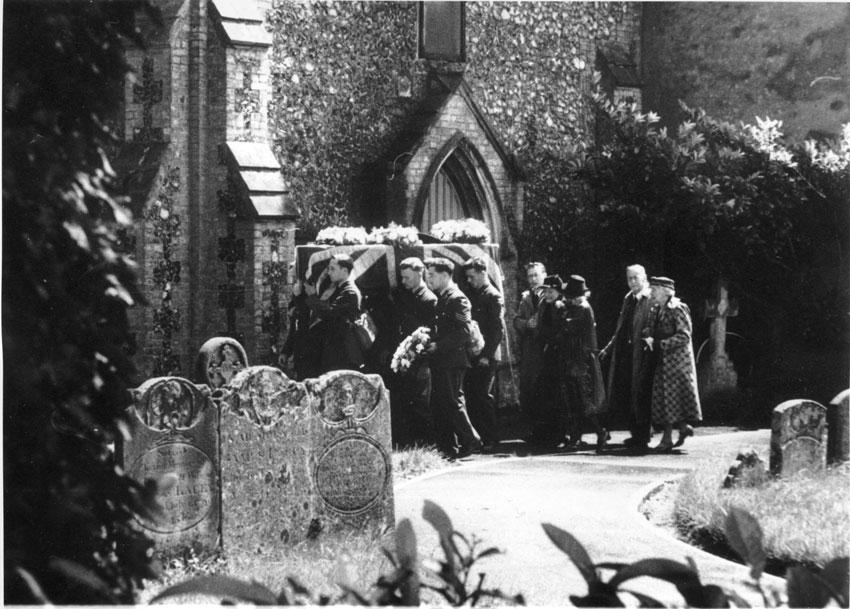 Entering church. Presumed relatives following.