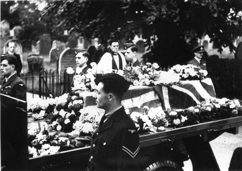 Arrival at Church Note both USA and British Flags on Coffin. Revd. James Royan conducting service. He was here April 1942 to August 1943