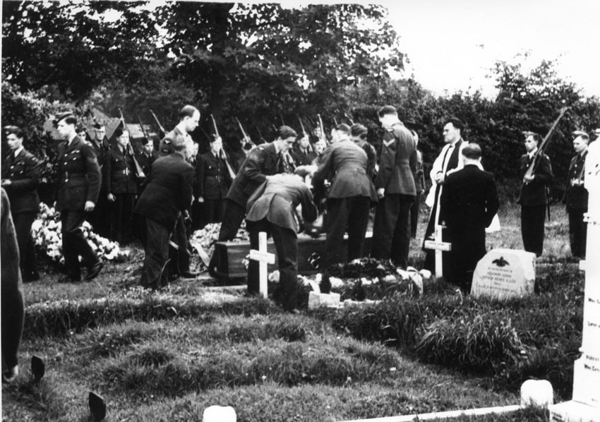 The internment. Note three new, but unmarked graves in foreground. It is thought that they are members of the crew of a JU88 shot down at Scoulton. There are no graves in this position today