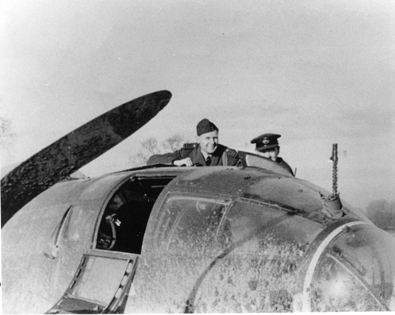 RAF officers jubilantly inspecting the Heinkel HE111 at Ovington