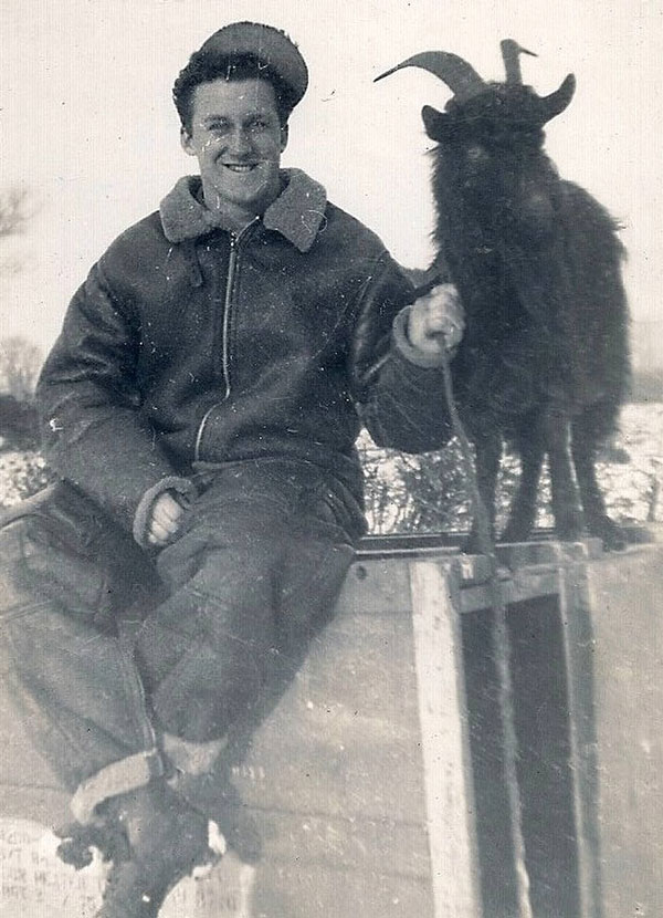 Ray Dorman from Weymouth, Massachusetts and a goat kept on the station